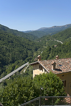 Modern Via Salaria, passing in the same valley of the ancient Roman Via Salaria, seen from Arquata del Tronto fortified hill town, province of Ascoli Piceno, Marches, Italy, Europe
