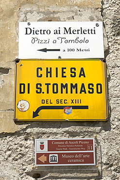 Various signs indicating an artisan shop selling bobbin lace, the church San Tommaso, and the Museum of Ceramic Art, in Ascoli Piceno, Marches, Italy, Europe