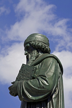 Half portrait, Johannes Gutenberg, with bible in his arms, Gutenberg monument, Mainz, Rhineland-Palatinate, Germany, Europe