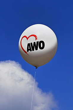 Balloon with an AWO logo against a blue sky with a cloud, AWO, worker's welfare organisation