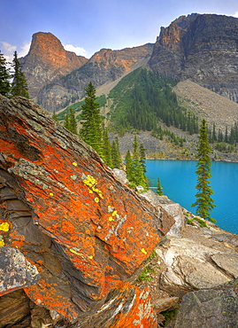 Moraine Lake, colored lichen on rock, Wenkchemna Range Mountains, Valley of the Ten Peaks, Banff National Park, Canadian Rocky Mountains, Alberta, Canada