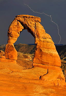 Delicate Arch, a natural stone arch, during a thunderstorm with lightning, Arches National Park, Moab, Utah, Southwest, United States of America, USA