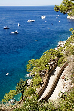View over Via Krupp with boats in the bay in front of Marina Piccola, island of Capri, Italy, Europe