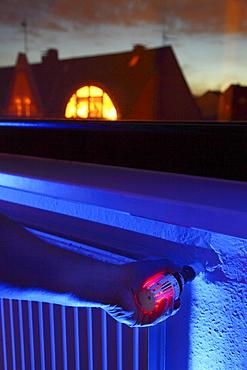 Radiator with thermostat, illuminated, window, heating costs