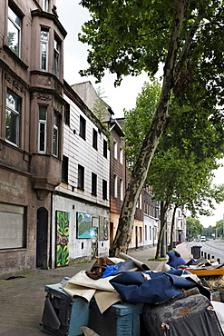 Bulk waste on the roadside, Kaiser-Wilhelm-Strasse, Bruckhausen district, Duisburg, North Rhine-Westphalia, Germany, Europe