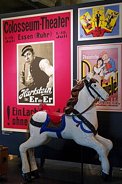 Historic poster of the Colosseum Theater Essen and a carousel horse, New Ruhr Museum, Zollverein Coal Mine Industrial Complex, Essen, North Rhine-Westphalia, Germany, Europe