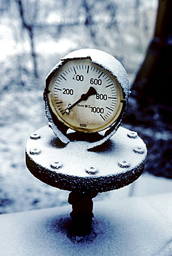 Snow-covered pressure gauge, Huettenwerk Meiderich steel mill after closure, today Duisburg-Nord Landscape Park, North Rhine-Westphalia, Germany, Europe