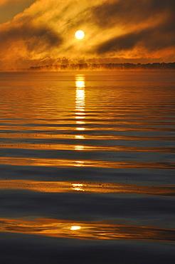Sun reflected in waves, Pewaukee Lake, Wisconsin, USA, America