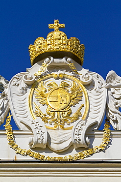 Imperial crown and coat of arms on the roof of the Hofburg Imperial Palace, Vienna, Austria, Europe