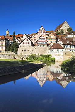 Houses of the old town reflected in the Kocher river, Schwaebisch Hall, Hohenlohe, Baden-Wuerttemberg, Germany, Europe