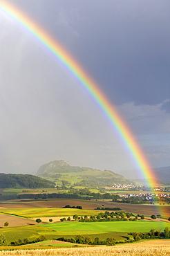View on Mt. Hohentwiel through a rainbow, Hegau region, Landkreis Konstanz county, Baden-Wuerttemberg, Germany, Europe