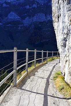 Safe trail path along the cliff of the Ebenalp between the Wildkirchli caves and Aescher mountain restaurant, Canton Appenzell-Innerrhoden, Switzerland, Europe