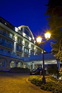Luxury Hotel Grand Hotel Bellevue, in front a Aston Martin DB9, Gstaad, Switzerland, Europe