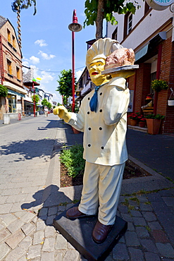 Chef and roast, advertising character outside a restaurant