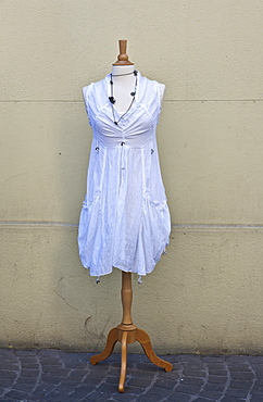 Dressmaker's dummy with a white dress