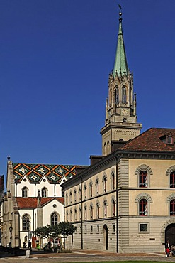 Laurenzkirche church, 1850-1854, with colourful roof, on the right the Zeughausfluegel wing of the Neue Pfalz residence, Marktgasse 25, St. Gallen, Switzerland, Europe