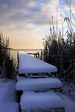 Snow on old wooden pier, lake Chiemsee, Chiemgau, Upper Bavaria, Germany, Europe