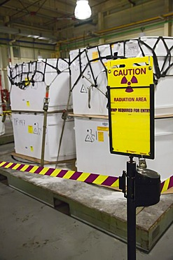 Containers filled with transuranic nuclear waste from America's nuclear weapons program await burial at the Waste Isolation Pilot Plant; the radioactive materials are then stored in rooms carved out of an ancient salt formation a half mile below the Chihu