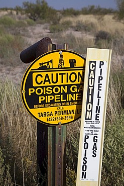 A sign warns of an underground natural gas pipeline in Grandfalls, west Texas, USA