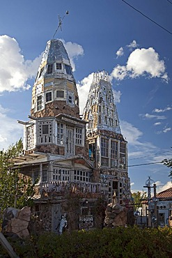 """Cano's Castle, built by Donald """"Cano"""" Espinoza, a Native American and Vietnam veteran who built the Christian-themed structure from beer cans, hub caps, and other scrap materials, in thanks for his life being spared in Vietnam, Antonito, Colorado, USA"""
