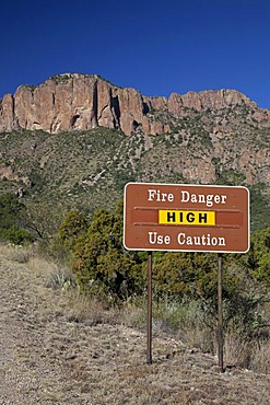A sign warns of high danger of fire in the Chisos Mountains of Big Bend National Park, Big Bend National Park, Texas, USA