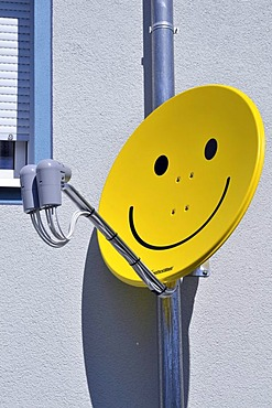 Satellite dish with smiley face, Germany, Europe
