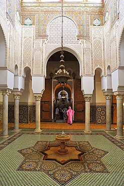 Partial view, interior with wash fountains, columns, stucco ornaments and tile mosaics in the Mausoleum of Moulay Ismail, Meknes, Morocco, Africa