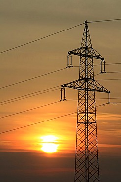 Electricity pylon at sunrise