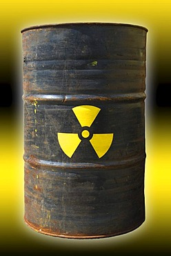 Rusty barrel with a radiation warning symbol