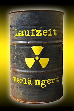 "Rusty barrel with a radiation warning symbol and lettering ""Laufzeit verlaengert"", German for ""extended runtime"""