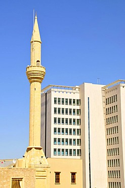 Minaret in front of a high-rise building in the historic centre of Beirut, Lebanon, Middle East, Asia