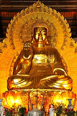 Buddha statue, the largest and heaviest bronze statue in Vietnam inside the Chua Bai Dinh pagoda, currently a construction site, to become one of the largest pagodas in Southeast Asia, near Ninh Binh, Vietnam, Southeast Asia