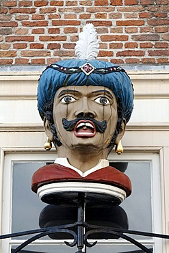 Bust of a man wearing a turban with a pill on the tongue, historic store sign of a pharmacy, Goes, Zeeland province, Netherlands, Benelux, Europe
