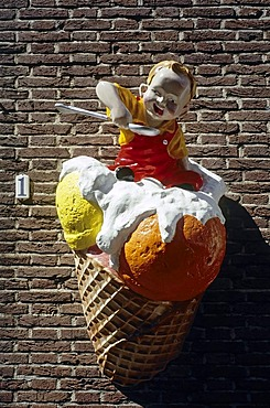 Child with spoon sitting on an ice-cream cone, advertising character on an ice cream parlor, Veere, Walcheren, Zeeland, Netherlands, Benelux, Europe