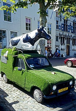 Inventive car with a cow on the roof, body covered with artificial turf, Veere, Walcheren, Zeeland, Netherlands, Benelux, Europe