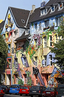 Kiefernstrasse street, houses of former squatters, artistically painted facades in street art style, Duesseldorf-Flingern, North Rhine-Westphalia, Germany, Europe