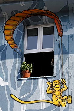Monkey hanging from a parachute, window in artistically painted house, street art style, Kiefernstrasse, Duesseldorf-Flingern, North Rhine-Westphalia, Germany, Europe