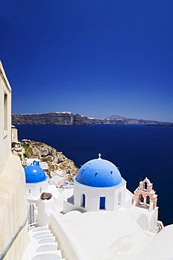 View from Oia across the caldera to Fira, Oia, Santorini, Cyclades, Greece, Europe