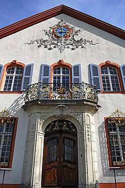 Ornamental facade at the entrance of Castle Buergeln with clock and balcony, built by Franz Anton Bagnato in 1762, early Classicism style, Schliengen, Baden-Wuerttemberg, Germany, Europe