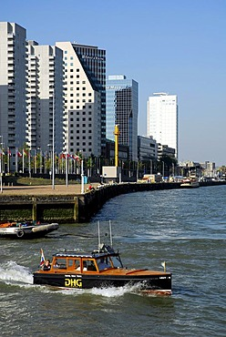 Small watertaxi ferry boat on the Nieuwe Maas River, modern architecture at the Boompjes quay at back, Rotterdam, Zuid-Holland, South-Holland, Netherlands, Europe