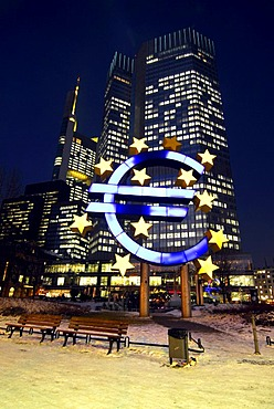 Euro sculpture, symbol of the European currency, ECB, European Central Bank in the evening, snowy Willy-Brandt-Platz square, Frankfurt am Main, Hesse, Germany, Europe