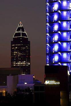 Messeturm fair tower by architect Helmut Jahn, Union Investment office building illuminated in blue, Bahnhofsviertel quarter, Frankfurt am Main, Hesse, Germany, Europe