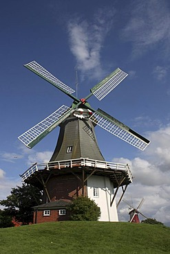 Green twin windmill in Greetsiel, East Frisia, Lower Saxony, Germany, Europe