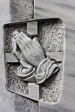 Praying hands on a tombstone