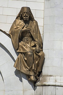 Bronze saint statue on the wall of the Christ the Saviour cathedral, Moscow, Russia