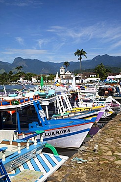 Chapel of Santa Rita and colourful boats in colonial town of Paraty, Costa Verde, State of Rio de Janeiro, Brazil, South America