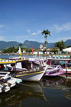 Colourful tourist boats in colonial town of Paraty, Costa Verde, State of Rio de Janeiro, Brazil, South America