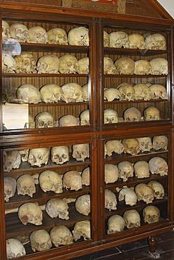 Martyrs' skulls and bones, ossuary, former windmill, Arkadi Monastery, Moni Arkadi, National Monument, Crete, Greece, Europe