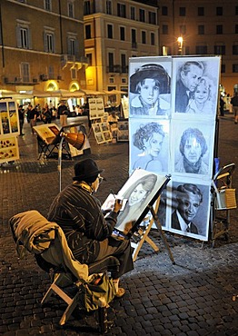 Street artist in the Piazza Navona square at night, Rome, Lazio, Italy, Europe