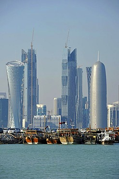Tradition and modernity, dhow wooden cargo ships in front of the skyline of Doha, Qatar, Persian Gulf, Middle East, Asia